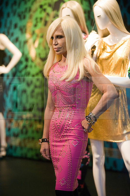 © London News Pictures. 17/11/2011. London, UK. Donatella Versace poses in front some of the new designs at the launch of the H&M Versace collection at the Regent Street store, London today (17/11/2011). Shoppers had queued for nearly 24 hours to be first in line for Versace's hotly anticipated collection : Ben Cawthra/LNP
