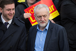 © Licensed to London News Pictures . 04/12/2015 . Oldham , UK . JEREMY CORBYN joins winning candidate JIM MCMAHON on the steps of Chadderton Town Hall in Oldham for a victory rally following Labour's success in the Oldham West and Royton by-election . Photo credit : Joel Goodman/LNP