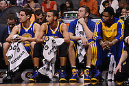 Dec 15, 2013; Phoenix, AZ, USA; Golden State Warriors guard Klay Thompson (11) , guard Stephen Curry (30) , forward David Lee (10) and guard Kent Bazemore (20) watch from the bench in the first half against the Phoenix Suns at US Airways Center. The Suns defeated the Warriors 106-102. Mandatory Credit: Jennifer Stewart-USA TODAY Sports