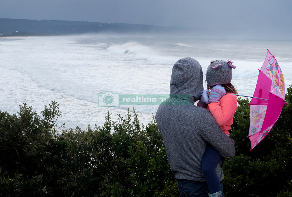 South Africa - Plettenberg Bay - 26 May 2020 - Locals visit the Whale Tail view site to watch the waves crashing onto Lookout Beach in Plettenberg Bay. A cold front has brought snow to mountains and other high altitude areas in the Western Cape. Along the coast, high seas and strong swells battered shores while occasional downpours of rain fell over the region. South Africa is currently under lockdown in an attempt to flatten the curve to halt the spread of the COVID-19 coronavirus pandemic. Picture: David Ritchie/African News Agency(ANA)