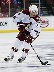 Mar 12, 2009; Newark, NJ, USA; Phoenix Coyotes left wing Scottie Upshall (8) skates with the puck during the first period at the Prudential Center.
