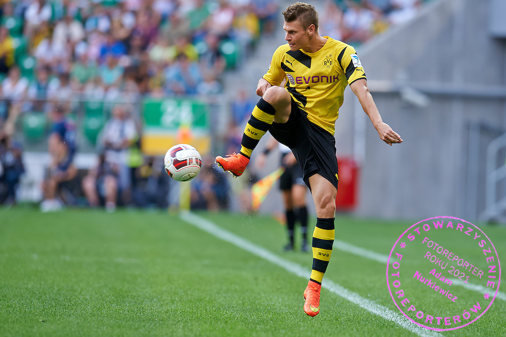 Lukasz Piszczek of Dorussia Dortmund controls the ball during international friendly soccer match between WKS Slask Wroclaw and BVB Borussia Dortmund on Municipal Stadium in Wroclaw, Poland.<br /> <br /> Poland, Wroclaw, August 6, 2014<br /> <br /> Picture also available in RAW (NEF) or TIFF format on special request.<br /> <br /> For editorial use only. Any commercial or promotional use requires permission.<br /> <br /> Mandatory credit:<br /> Photo by &copy; Adam Nurkiewicz / Mediasport