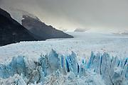 Southern terminus of Perito Moreno Glacier showing crevasses and advancing ice.