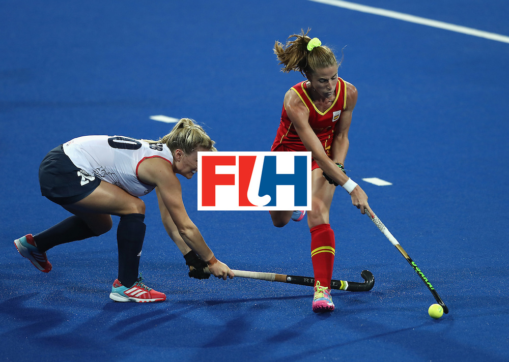 RIO DE JANEIRO, BRAZIL - AUGUST 15: Berta Bonastre (R) of Spain moves away from Hollie Webb during the Women's quarter final hockey match between Great Britain and Spain on Day10 of the Rio 2016 Olympic Games held at the Olympic Hockey Centre on August 15, 2016 in Rio de Janeiro, Brazil.  (Photo by David Rogers/Getty Images)
