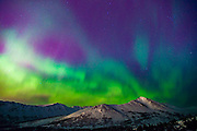 The Northern Lights shine over the Chugach Mountains outside Anchorage, Alaska.