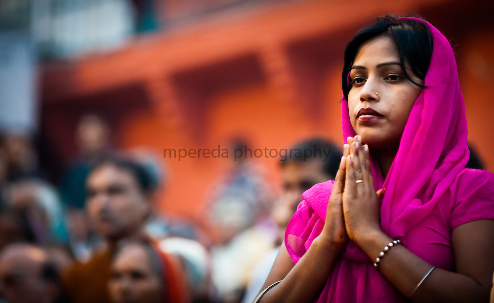 Woman praying in the ghats, Varanasi