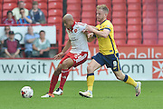 Alex Baptiste (21) of Sheffield United under attack from Paddy Madden of Scunthorpe United during the Sky Bet League 1 match between Sheffield Utd and Scunthorpe United at Bramall Lane, Sheffield, England on 8 May 2016. Photo by Ian Lyall.