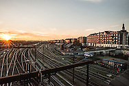 The sunsets over the train tracks at Dybbølsbro Station along Ingerslevsgade in Copenhagen