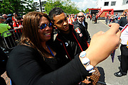 AFC Bournemouth forward Joshua King having a selfie taken with a female fan on arrival for the Premier League match between Bournemouth and Burnley at the Vitality Stadium, Bournemouth, England on 13 May 2017. Photo by Graham Hunt.
