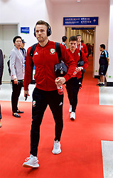 NANNING, CHINA - Monday, March 26, 2018: Wales' Chris Gunter arrives before the 2018 Gree China Cup International Football Championship Final between Wales and Uruguay at the Guangxi Sports Centre. (Pic by David Rawcliffe/Propaganda)