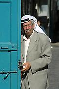 old man closing his shop in bethlehem