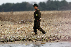 A North Korea soldier walks along the North Korean bank of the Yalu River near the town of Sinuiji across the Chinese city of Dandong, Liaoning Province, China on 06 April 2013. North Korean leader Kim Jong-un has ordered the country's military to increase artillery production, a televised report out of Pyongyang showed 06 April.