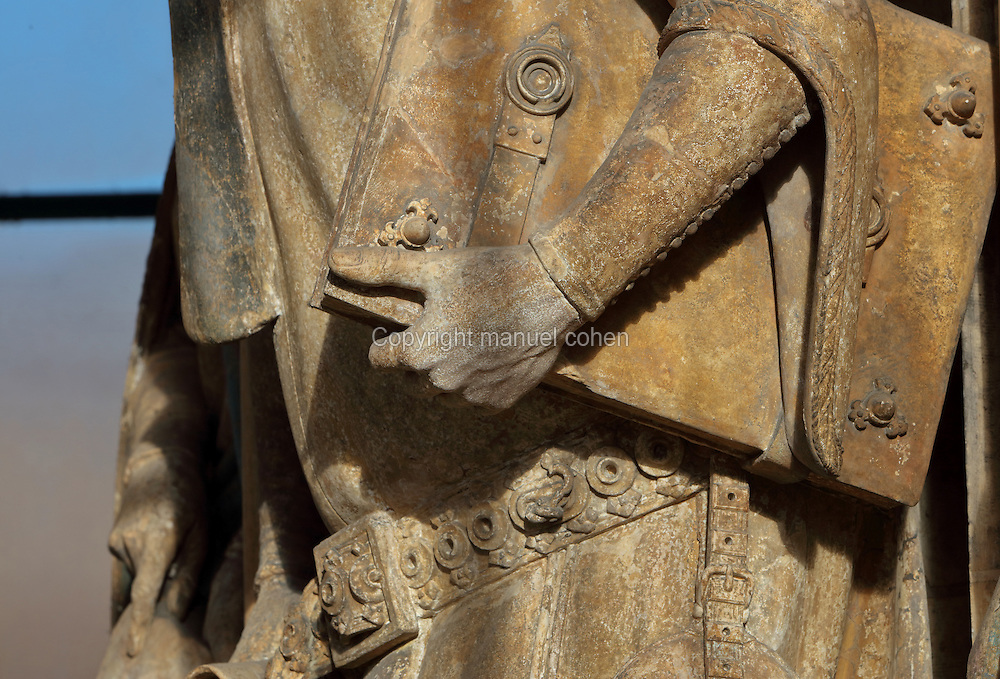 Detail of the book in Isaiah's hand, from the Puits de Moise, or Well of Moses, 1395-1403, sculpted by Claus Sluter, 1340-1406, and his studio, and painted by Jean Malouel, 1365-1415, in the courtyard of the Chartreuse de Champmol, the burial site of Philippe le Hardi duc de Bourgogne, or Philip the Bold Duke of Burgundy, now the Hospital de la Chartreuse, Dijon, Burgundy, France. The sculpture was commissioned by Jean sans Peur or John the Fearless, and consists of a crucifixion scene surrounded by 6 prophets (Moses, David, Jeremiah, Zachariah, Daniel and Isaiah), with 6 weeping angels. The hexagonal building surrounding the sculpture was added in the 17th century. Picture by Manuel Cohen