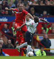 Photo: Paul Thomas.<br /> England v Andorra. European Championships 2008 Qualifying. 02/09/2006.<br /> <br /> Antonio Lima Sola of Andorra (L) jumps to try and win the ball from Jermaine Defoe.