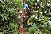 Peru - Monday, Dec 09 2002: Researchers prepare their equipment in order to monitor the Scarlet macaw chicks. The research project is based at  Tambopata Research Centre, Puerto Maldonado. (Photo by Peter Horrell / http://www.peterhorrell.com)