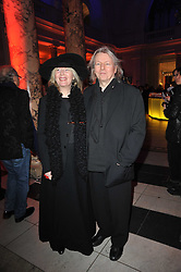 Playwrite CHRISTOPHER HAMPTON and his wife LAURA at a private view to celebrate the opening of the V&A's exhibition of Yohji Yamamoto fashion designs held on 10th March 2011.