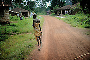 In Kerfey village near Lunsar in Sierra Leone, this woman is chained to keep her from running away as she is mentally disturbed. The region's health facilities are almost non-existent: The health centre has just one health worker and only the most basic medical provisions, the referral hospital is several hours drive away. Most people in this village cannot afford to get transport there.