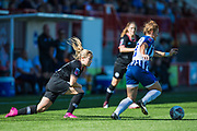 Fliss Gibbons (Brighton) away with the ball from Erin Cuthbert (Chelsea) during the FA Women's Super League match between Brighton and Hove Albion Women and Chelsea at The People's Pension Stadium, Crawley, England on 15 September 2019.
