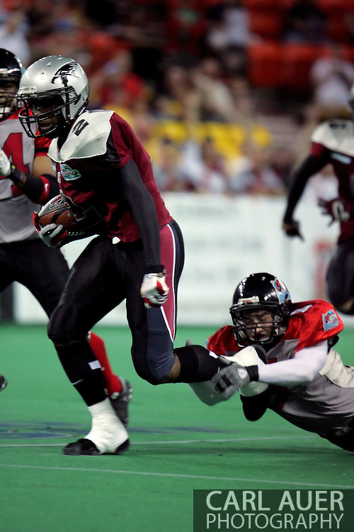 6-28-2007: Anchorage, AK - Alaska's Demarcus Morris (2)  is caught from behind by Quentin Lankford (5) in the Alaska Wild 47 to 53 loss to the CenTex Barracudas at the Sullivan Arena...