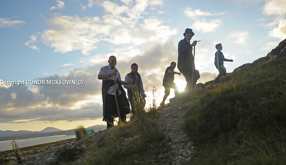 Early Risers <br />Pilgrims start their climb of Croagh Patrick on Reek Sunday.<br />Photo Conor McKeown