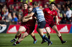 September 30, 2017 - Limerick, Ireland - Rory Scannell of Munster tackled by Jarrod Evans of Cardiff during the Guinness PRO14 Conference A Round 5 match between Munster Rugby and Cardiff Blues at Thomond Park in Limerick, Ireland on September 30, 2017  (Credit Image: © Andrew Surma/NurPhoto via ZUMA Press)
