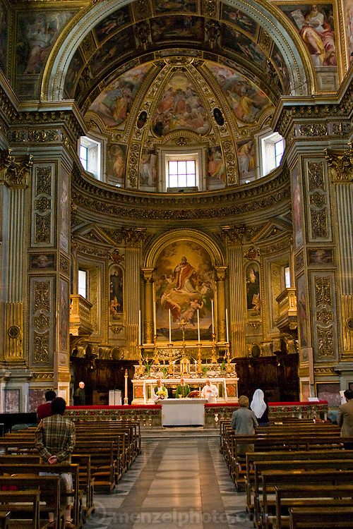 The interior of the San Marcello al Corso Church in Rome, Italy, where Riccardo Casagrande, monk brother priest leads a morning mass.   (Riccardo Casagrande is featured in the book, What I Eat: Around the World in 80 Diets.) Casagrande is in charge of the kitchen, garden, and wine cellar for the brotherhood.