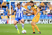 Colchester Utd midfielder Sammie Szmodics tackles Cambridge Utd midfielder James Dunne during the EFL Sky Bet League 2 match between Colchester United and Cambridge United at the Weston Homes Community Stadium, Colchester, England on 13 August 2016. Photo by Nigel Cole.