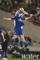 MANCHESTER, ENGLAND - Monday, February 25, 2008: Everton's Tim Cahill and Manchester City's Nedum Onuoha during the Premiership match at the City of Manchester Stadium. (Photo by David Rawcliffe/Propaganda)