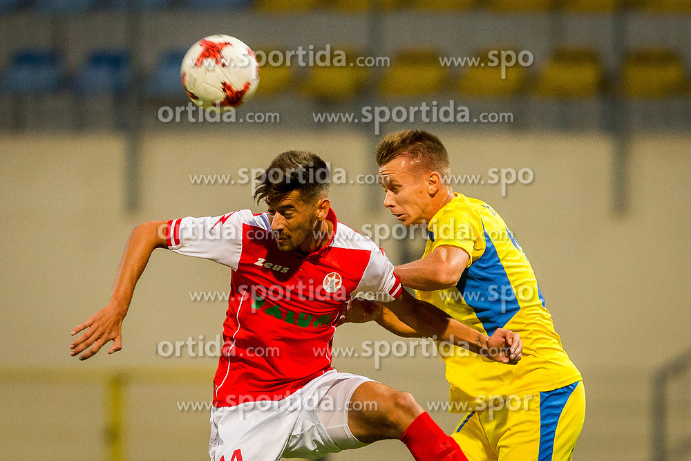 Nermin Hodzic of NK Domzale and Mario Jurcevic of NK Aluminij during football match between NK Domžale and NK Aluminij in 6th Round of Prva liga Telekom Slovenije 2017/18, on August 20, 2017 in Sports park Domzale, Domzale. Photo by Ziga Zupan / Sportida