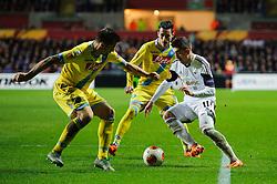 Swansea Midfielder Pablo Hernandez (ESP) is challenged by Napoli Midfielder Cristian Maggio (ITA) - Photo mandatory by-line: Rogan Thomson/JMP - Tel: 07966 386802 - 20/02/2014 - SPORT - FOOTBALL - Liberty Stadium, Swansea -  Swansea City v SSC Napoli - UEFA Europa League, Round of 32, First Leg.