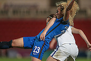 Kheira Hamraoui (France) stretches for the ball while being closely marked by an England defender during the International Friendly match between England Women and France Women at the Keepmoat Stadium, Doncaster, England on 21 October 2016. Photo by Mark P Doherty.