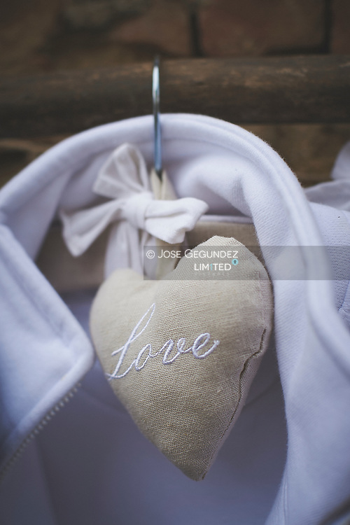 Love written in heart hanging on hanger