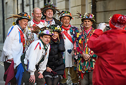 "© Licensed to London News Pictures. 01/05/2018. Oxford, UK. Morris dancers in dress pose for a photograph with a tourist as they prepare to dance next to Hertford Bridge, often called ""the Bridge of Sighs"" in Oxford, Oxfordshire as part of May Day celebrations. Students were again prevented from jumping from Magdalen Bridge in to the river, which has historically been a tradition, due to injuries at a previous years event . Photo credit: Ben Cawthra/LNP"