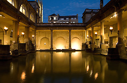 Bath, Somerset, England: The Great Bath at night. An extensive Roman bathing establishment that flourished between the first and fifth centuries AD in what the Romans called Aquae Sulis, this living museum remains mostly intact today.  It was built around a natural hot spring which continues to bubble up at 46 degrees Centigrade from beneath the earth's surface.  The baths included a temple to Minerva, goddess of the thermal spring, and remains of that place of pilgrimmage are part of the bath house today.