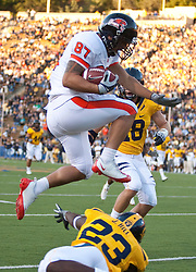 November 7, 2009; Berkeley, CA, USA;  Oregon State Beavers tight end Joe Halahuni (87) hurdles California Golden Bears cornerback Josh Hill (23) during the first quarter at Memorial Stadium.