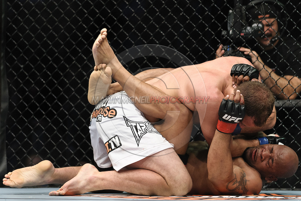 """NEWARK, NEW JERSEY, MARCH 27, 2010: Jared Hamman (top) and Rodney Wallace are pictured during their bout at """"UFC 111: St. Pierre vs. Hardy"""" in the Prudential Center, New Jersey on March 27, 2010"""