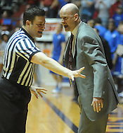 Mississippi coach Andy Kennedy, right, argues with an official during a game against Memphis during the NIT on Friday, March 19, 2010.