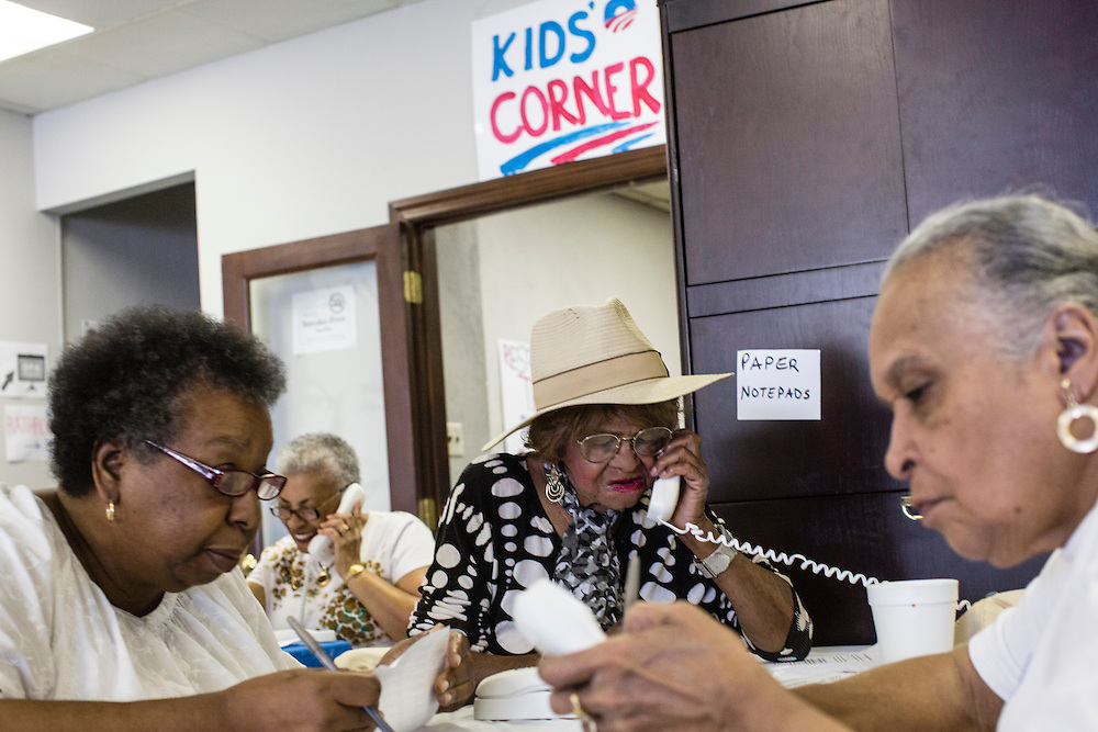 Wilnette Jasey, left, Audrey Britt, second from right, and Jackie Koiner, right, volunteers with Organizing for America, President Obama's re-election campaign arm, make phone calls to potential supporters in the group's Richmond headquarters on Thursday, May 3, 2012 in Richmond, VA.