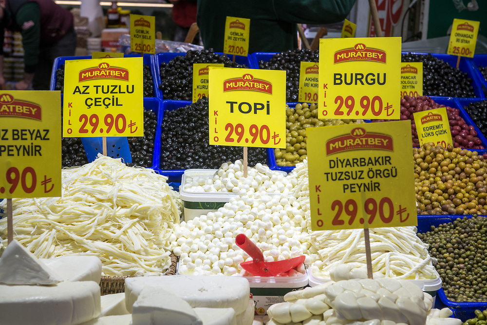 Different types of cheeses and olives on display for sale at Istanbul Spice bazaar in Turkey