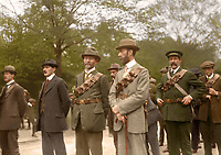 Eoin MacNeill (3rd from right) and members of the Irish Volunteers. Originally from Antrim and a Professor of History at UCD, MacNeill had led the public call for the formation of the Volunteers in 1913 and continued to lead them after they had split in late 1914. Note the belt buckles, which members usually wore as a cheaper alternative to uniforms. (Part of the Independent Newspapers Ireland/NLI Collection) Colourised by Tom Marshall (PhotograFix).