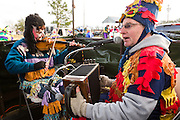 Traditional Cajun Mardi Gras musicians during the Courir de Mardi Gras chicken run on Fat Tuesday February 17, 2015 in Eunice, Louisiana. Cajun Mardi Gras involves costumed revelers competing to catch a live chicken as they move from house to house throughout the rural community.