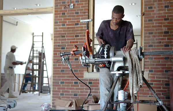 Tarrell Jackson of American Fire Sprinkler Inc. out of Jackson works on cutting pipes used for renovating the Levee Street Depot on Thursday  after it was inundated during the 2011 Mississippi River Flood. (Bryant Hawkins/The Vicksburg Post)