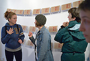 Lindsay Whalen, left, and Lauren Laplante talk during the opening reception at Artspeak Gallery. Emily Davidson, far right, a Neighbourhood Spaces artist in residence, is showing student and hher work created during her six weeks in Windsor. The show is part of MayWorks Windsor 2014.