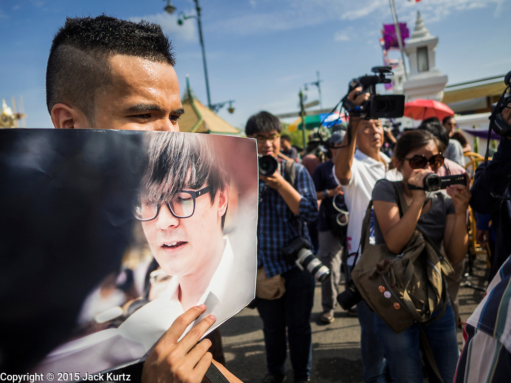 07 JULY 2015 - BANGKOK, THAILAND: Student activists rally at the Ministry of Defense and hold photos of the 14 students arrested by the military. About 100 people gathered in front of the Ministry of Defense in Bangkok Tuesday to support 14 university students arrested two weeks ago for violating orders against political assembly. They're facing criminal trial in military courts. The courts ordered their release Tuesday because they can only be held for two weeks without trial, the two weeks expired Tuesday and the military court chose not to renew their pretrial detention. The court order was not an acquittal. They still face trial and possible prison sentences if convicted.        PHOTO BY JACK KURTZ