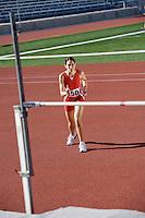Female athlete high-jumping