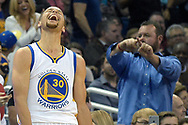 Golden State Warriors guard Stephen Curry (30) celebrates after making a three-pointer from near the half-court line at the end of the third quarter of an NBA basketball game against the Orlando Magic in Orlando, Fla., Thursday, Feb. 25, 2016. The Warriors won 130-114. (AP Photo/Phelan M. Ebenhack)