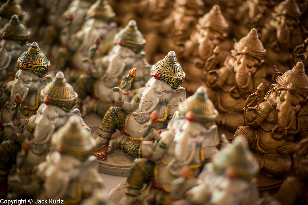 "29 SEPTEMBER 2012 - NAKORN NAYOK, THAILAND:   Statues of Ganesh at Ganesh Ustav celebrations at Wat Utthayan Ganesh, a temple dedicated to Ganesh in Nakorn Nayok, about three hours from Bangkok. Many Thai Buddhists incorporate Hindu elements, including worship of Ganesh into their spiritual life. Ganesha Chaturthi also known as Vinayaka Chaturthi, is the Hindu festival celebrated on the day of the re-birth of Lord Ganesha, the son of Shiva and Parvati. The festival, also known as Ganeshotsav (""festival of Ganesha"") is observed in the Hindu calendar month of Bhaadrapada, starting on the the fourth day of the waxing moon. The festival lasts for 10 days, ending on the fourteenth day of the waxing moon. Outside India, it is celebrated widely in Nepal and by Hindus in the United States, Canada, Mauritius, Singapore, Thailand, Cambodia, Burma , Fiji and Trinidad & Tobago.    PHOTO BY JACK KURTZ"