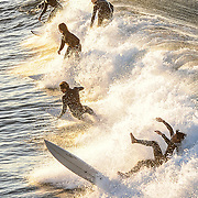11/3/167:30:40 AM --- Surfing ----<br /> <br /> Members of the Huntington Beach high school surf team practice riding the waves during an early morning session next to the Huntington Beach Pier on Thursday, Nov. 3, 2016.<br /> <br /> Photo by Claire Rounkles, Sports Shooter Academy