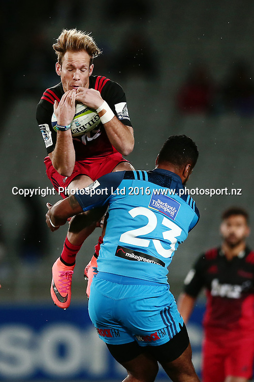 Marty McKenzie of the Crusaders takes a high ball against Lolagi Visinia of the Blues. Super Rugby match, Blues v Crusaders at Eden Park, Auckland, New Zealand. 28 May 2016. Photo: Anthony Au-Yeung / www.photosport.nz
