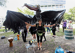 20 April 2015. New Orleans, Louisiana.<br /> Gulf South Rising.<br /> Renate Heurich wearing an oiled pelican costume joins protesters to mark the 5th anniversary of the disastrous BP Macondo Well blowout in the Gulf of Mexico. The largest marine oil spill in history claimed 11 lives and witnessed an estimated 5 million barrels of oil polluting the Gulf. <br /> Photo; Charlie Varley/varleypix.com